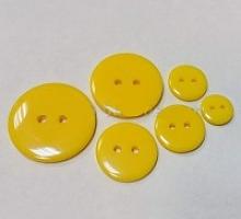 Пуговица пластиковая на прокол желтая