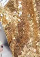Ткань с золотыми пайетками